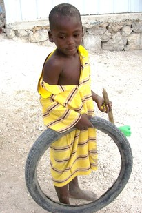 boy with tire toy cropped 2